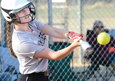 Kevin Harvison   Staff photo McAlester Lady Buffalo batter hits the ball against Broken Bow Thursday at the Pittsburg County Softball Complex.