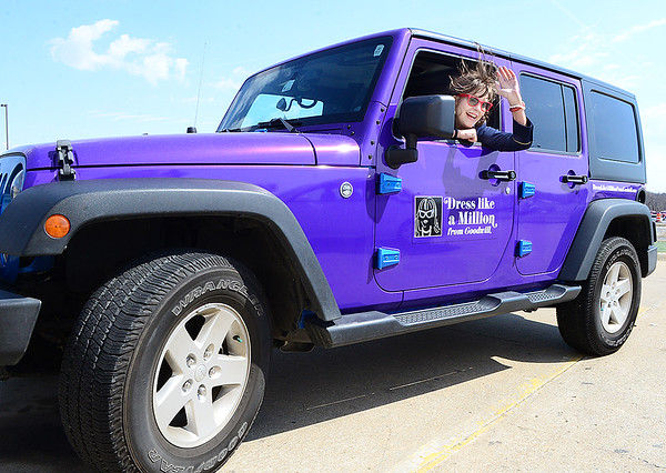 Kevin Harvison | Staff photo<br /> Jean Kelly waves from her custom Jeep as she prepares to go in to the McAlester Goodwill for a book signing Thursday.