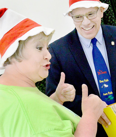 Kevin Harvison | Staff photo<br /> Pictured from left, Brenda Clahan introduces Oklahoma District 18 State Representative who read One Fish Two Fish to Jefferson Early Childhood Center in honor of Dr Seuss birthday.