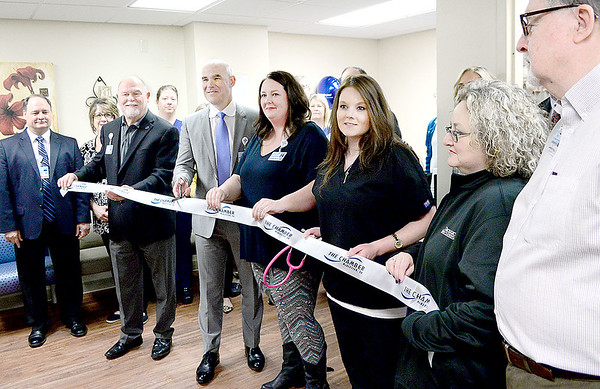 Kevin Harvison   Staff photo<br /> Pictured center, Dr. James L'Esperance, Urologic Specialist at Southeast Clinic speaks cuts a ribbon during a ceremony Thursday at their office located on the 2nd floor at 4 East Clark Bass Blvd.