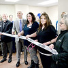Kevin Harvison | Staff photo<br /> Pictured center, Dr. James L'Esperance, Urologic Specialist at Southeast Clinic speaks cuts a ribbon during a ceremony Thursday at their office located on the 2nd floor at 4 East Clark Bass Blvd.