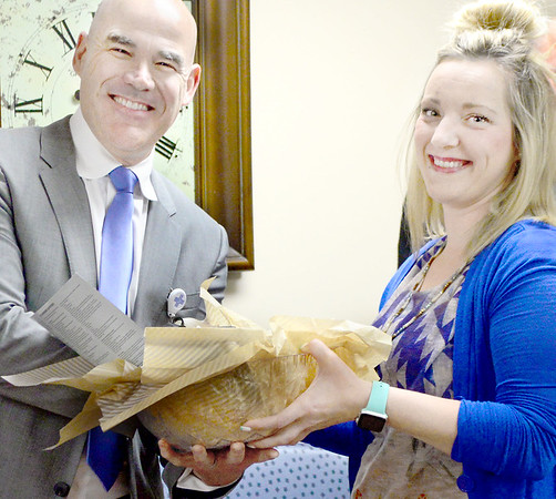 Kevin Harvison | Staff photo<br /> Pictured left, Dr. James L'Esperance, Urologic Specialist at Southeast Clinic receives a gift basket from CEO and President of the McAlester Chamber of Commerce Krystal Bess during a ribbon cutting ceremony Thursday at their office located on the 2nd floor at 4 East Clark Bass Blvd.