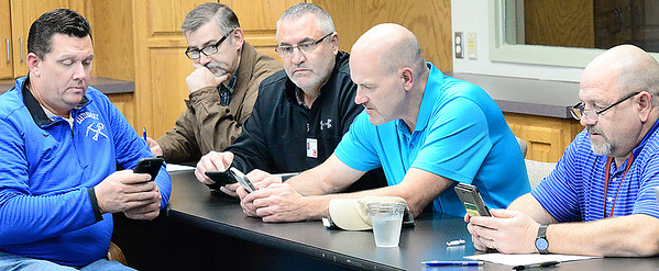 Kevin Harvison | Staff photo<br /> Area superintendents prepare for the start of the monthly Superintendents' Meeting at the Kiamichi Technology Center.
