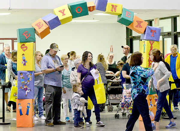 Kevin Harvison | Staff photo<br /> People enter the 2018 Kids Fair at the Southeast Expo Center Saturday.