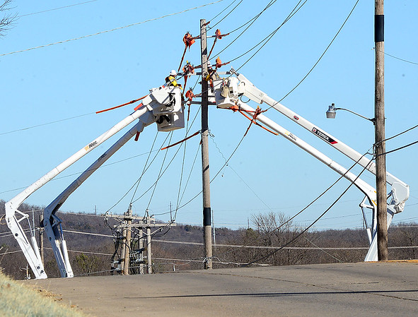 Kevin Harvison | Staff photo<br /> Line Tec Services work on north 6th Street during the project to replace a series of electrical power poles.