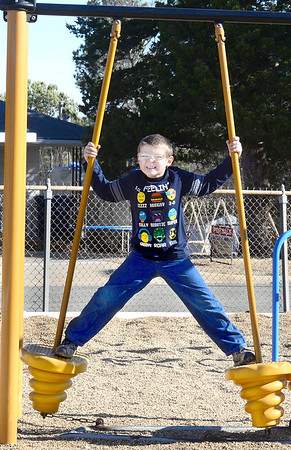 Kevin Harvison | Staff photo<br /> Kenneth Thompson does his best Stretch Armstrong imitation during a McAlester Public Schools recess.