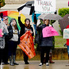 Kevin Harvison | Staff photo<br /> Teachers stand in the rain in front of the Federal Courthouse in McAlester Friday.