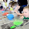 "Kevin Harvison | Staff photo<br /> A group of Jefferson Early Childhood Center students work on some ""bubble"" art with McAlester High School mentors at the Wanda Bass Fine Arts Center."