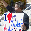 Kevin Harvison | Staff photo<br /> McAlester teacher Stephanie Walker holds a sign in front of the Carl Albert Federal Building Wednesday and waves to vehicles as they acknowledge her, a group of teacher and students; as a part of the State wide teacher walk out.