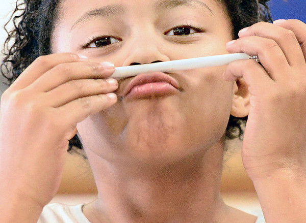 Kevin Harvison | Staff photo<br /> Emerson Elementary student T'Yanna James pauses as she thinks of an answer while finishing up a class project.