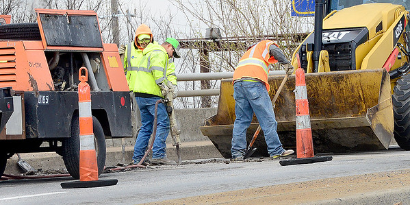 KEVIN HARVISON | Staff photo<br /> The Oklahoma Department of Transportation continues work on the overpass on West Carl Albert Parkway limiting the East bound traffic to one lane over the bridge.