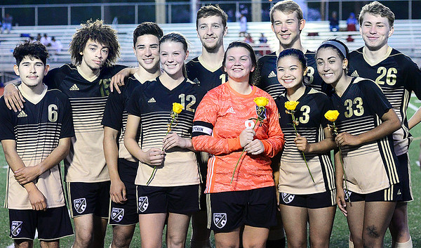 KEVIN HARVISON | Staff photo<br /> McAlester High School soccer seniors pose for a photo between the varsity girls game and the boys game after a mid field ceremony at Hook Eales Stadium Tuesday night.