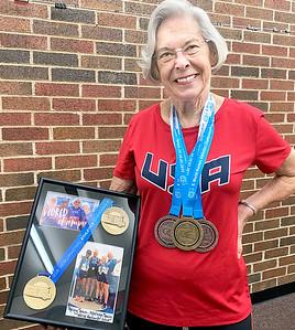 ADRIAN O'HANLON lll | Staff photo Carolyn Walter heldped a USATF Team set a record.