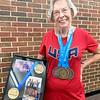 ADRIAN O'HANLON lll | Staff photo<br /> Carolyn Walter heldped a USATF Team set a record.