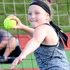 KEVIN HARVISON | Staff photo<br /> Rylan Lesnau prepares to throw in the girls fourth grade softball event. Lesnau won first place in the division during the McAlester All School Elementary Track Meet at Hook Eales Stadium.