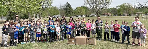 Staff photo by KEVIN HARVISON<br /> McAlester Regional Health Center's Wellness Center donated water bottles as incentives for the 100 Mile Club runner from Will Rogers. Pictured are Will Rogers students along with their coach Sharla Homer and MRHC Wellnes Center representatives Dr. Julie Collins, director, Natia Anderson, Lorey Westray and Will Rogers PTO Rachel Fields.