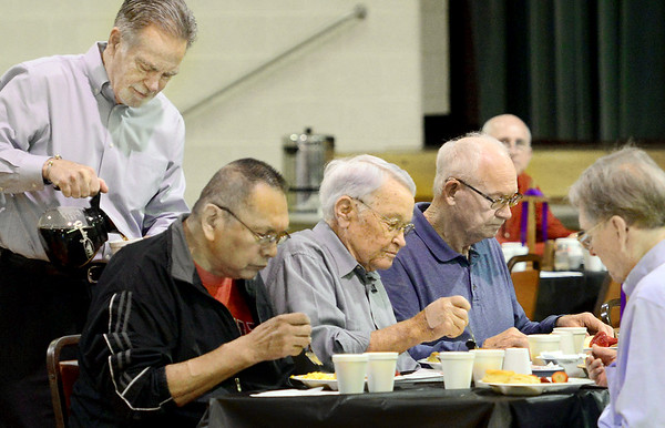 KEVIN HARVISON | Staff photo<br /> Men gather for breakfast at St. Johns Catholic Church Thursday morning, celebrating Men's Holy Week in McAlester.