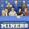 KEVIN HARVISON | Staff photo<br /> Hartshorne senior Gunner Hass signs a letter of intent to play baseball for Carl Albert. Pictured seated from left, Kinsler Hass, Jodi Hass, Josh Hass, Gunner Hass and Rocky Hass and standing from left, Miner Baseball Coach Justing James, Hartshorne Superintendant Jason Lindley and Carl Albert State College Assistant Baseball Coach Jacob Kelley
