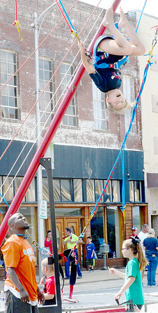 Kevin Harvison | Staff photo<br /> An unidentified girl reacts to a bungee jump on Choctaw Avenue Saturday during the Culture Fest celebration in McAlester.