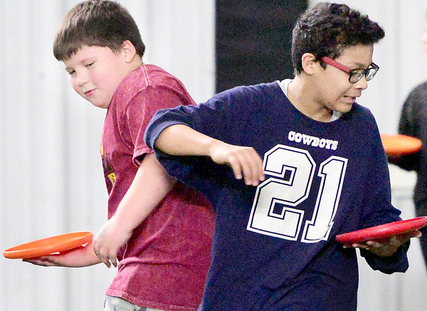 KEVIN HARVISON | Staff photo<br /> Karsen Smith, left and Brandon Pajaro avoid tags during a recent game of Pizza Tag.