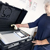 KEVIN HARVISON | Staff photo<br /> Alice Gragg, Inspector for Precinct 33 in Haileyville, checks the number of votes on the voting box Tuesday.