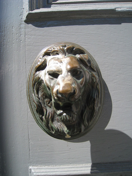 "Letter ""Slot"" through mouth of Lion."