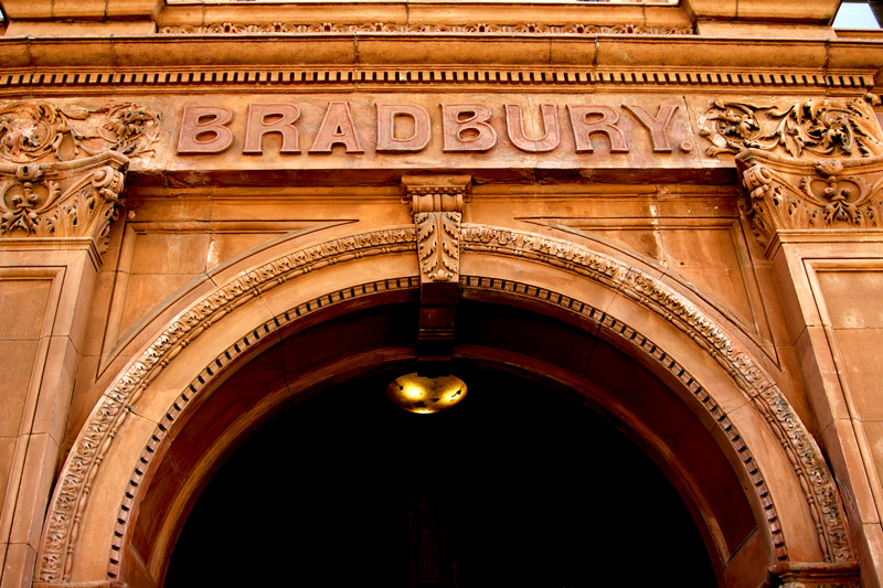 This is the top of the arched doorway, at the center of the building and facingBroadway Street.