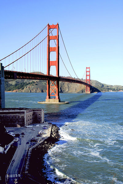 This photo of the Golden Gate bridge was taken from the south end. Fort Point is shown below the south end of the bridge. Fort Point is located at the southern side of the Straits of the Golden Gate at the entrance to San Francisco Bay. During the American Civil War, a fort was built to defend the against passage of hostile warships. The fort is now protected as Fort Point National Historic Site, a U.S. National Historic Site administered by the National Park Service as a unit of the Golden Gate National Recreation Area.<br /> <br /> The entrance to San Francisco Bay has long been the site of human habitation. The earliest residents of the area, ancestors of the Ohlone and Coast Miwok peoples, depended on the bay's waters for food and transportation. There is evidence from about 4,000 years ago of an Ohlone village located about a mile from Fort Point along the shore.<br /> <br /> Information above is from Wikipedia.