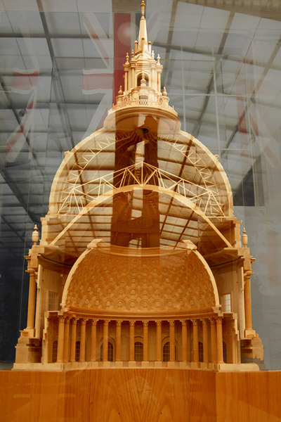 This huge cross section model of the city hall dome is encased in heavy glass and all the reflections of the ceiling and the wall beyond shows. I still took the picture as it explains visually the construction of the dome. This construction is similar to the Les Invalides dome in Paris.<br /> <br /> The dome itself is upported by steel trusses with a cupola on top. The ceiling that you see in the pictures is on the lowest part supported by colonnades and a compression collar beam at its top.