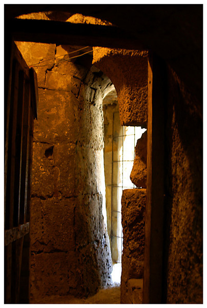 A view of the really old stone passgeway that leads towrads the stone stair up to the bell tower.