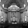 This is the altar of the historic Basilica of St. Martin of Tours. The site occupies a high promontory at the center of the City. The altar does not show much of its age but the exterior of the church does and everything else not within the area of the altar.