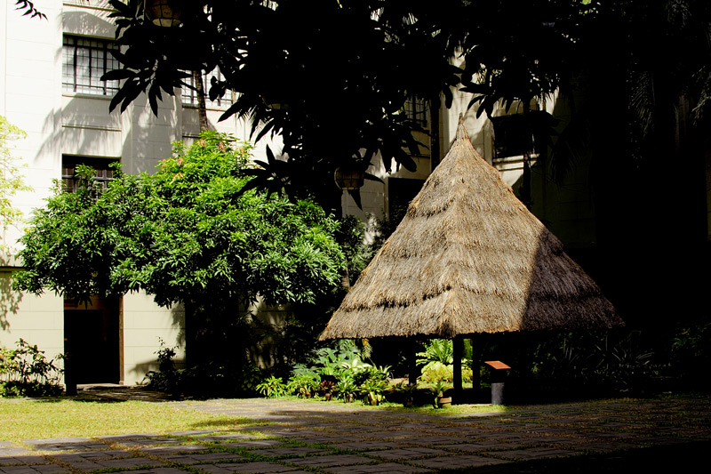 An authentic Ifugao House is shown on the courtyard of the Philippine National Museum. The thick thatch roof is bought the roof and siding of the house.