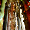A view up, inside the church where construction is going on. Note the beautiful colored lights cast by the stained glass.