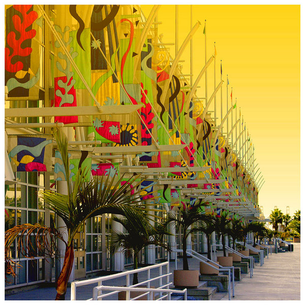 This is the Long Beach Convention Center with the front full of banners. Taken at sunset, although I purposely over enhanced the the yellow glow of the setting sun.