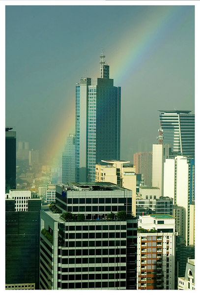 An early morning rainbow over the city of Makati. taken from the penthouse of the Golden Triangle Condominium. This was taken in January 2006.