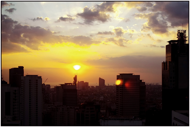 Sunset over Makati, taken from the penthouse of the Golden Triangle Condominium.