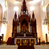 The beautiful wooden retablo altar provides the gothic focal point, with its rich tapestry of spires and niches crowned by pointed arches. The recently restored dome hints at the designs Romanesque influences.