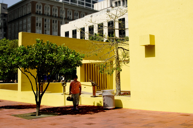 This yellow stucture houses the stairway, elevators and utility room for the plaza.