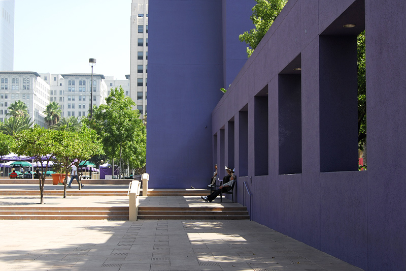 A view of one of several freestanding walls on the square. The blue wall beyond is of the symbol tower for the plaza.