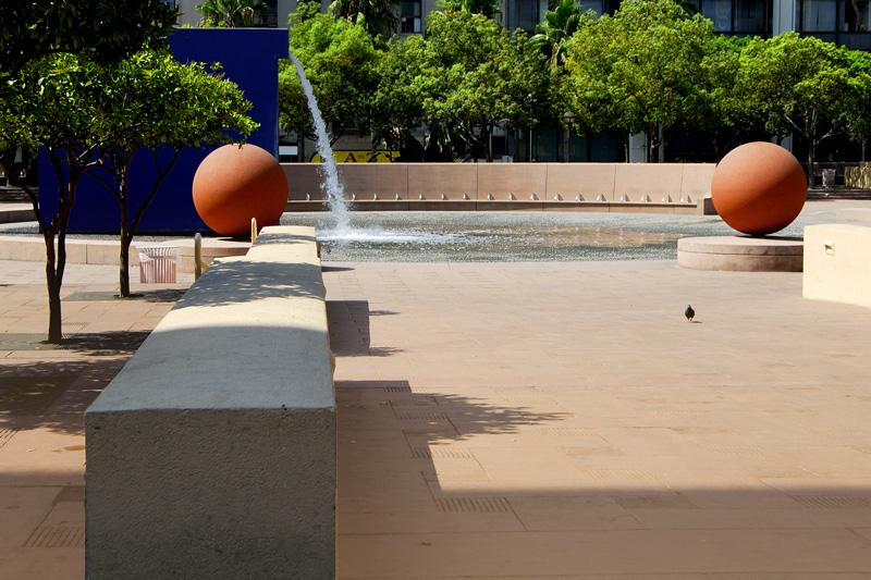 Here you see two red orange balls framing the fountain and reflecting pool. The street beyond with trees is Sixth Street.