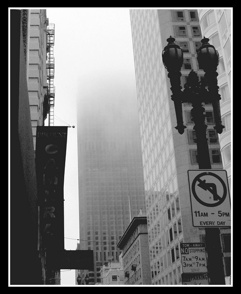 The sun has not yet set but it was dark already because the fog has come down low in the city. It is eerie when the fog engulfs those high rise buildings. The buildings just vanish from your eyes, the place gets cold and damp. The chill goes straight to your bone morrow. The people in the city welcomes it. They say it is part of the city's charm and character. As for me, I do not like it.