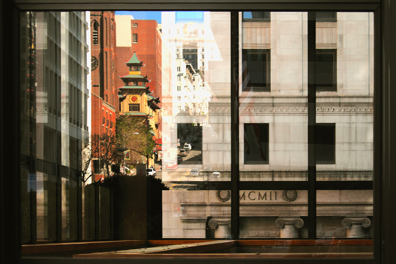 Reflections of buildings on the Bank of America Home Office Building.