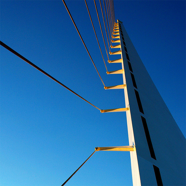 Taken at sunset time and the rays of the sun turns the cable outriggers to gold. When I saw it from afar, I run underneath it and took a picture.