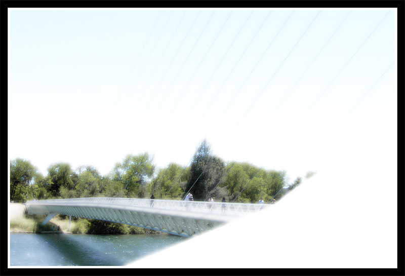In the heat and glare of the sun, the bridge image is like a mirage.
