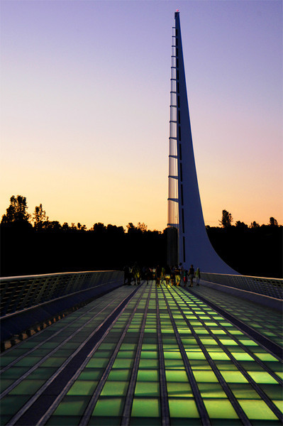 The flooring is of clear glass and is illuminated at night. Now it is popular not only as a bridge, but as an informal meeting place for the community.