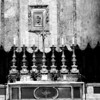A closer view of the main altar. A Madonna and Child made of glass mosaic is behind and above it.