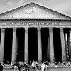 """Michelangelo said """"It was the work of angels, not men"""".<br /> <br /> The name comes from two Greek words pan, """"everything"""" and teon """"divine"""". Originally, the Pantheon was a small temple dedicated to all Roman gods. Built between 27 and 25 B.C. by the consul Agrippa, Prefect of the Emperor Augustus, the present building is the result of subsequent, heavy restructuring.<br /> <br /> Domitian, in 80 A.D., rebuilt it after a fire; thirty years later it was hit by lightening and caught fire again. It was then rebuilt in its present shape by the Emperor Hadrian; under his reign, Rome reached its maximum splendour, and the present structure is probably the fruit of his eclectic genius and exotic tastes.<br /> <br /> This is the front elevation of the Pantheon that has the portico in front. The building faces the Piazza Della Rotonda.<br /> <br /> Some information shown above was taken from  <a href=""""http://www.italyguides/"""">http://www.italyguides/</a>"""