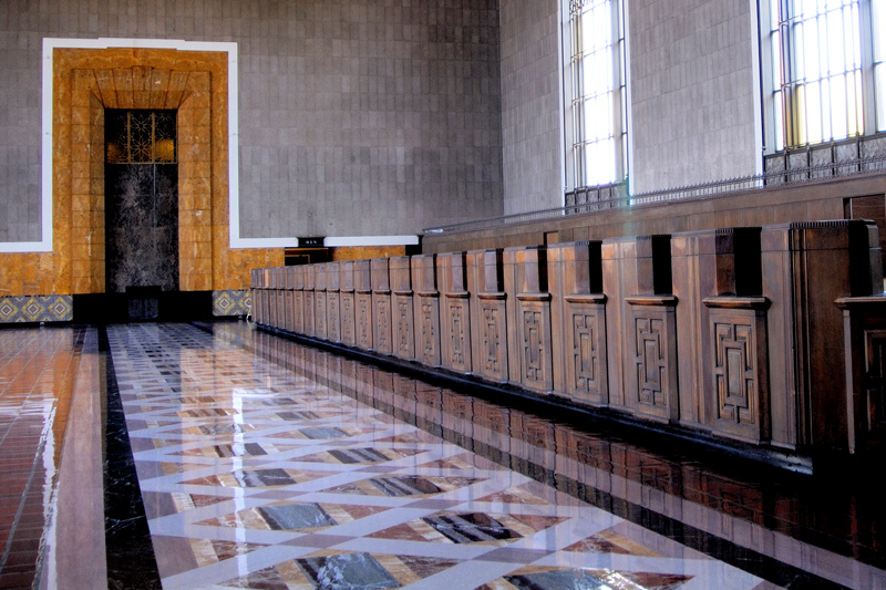 "A closer view of the nice floor design and the attractive carved wood ticketing counters.<br /> <br /> This station served as a backdrop for the 1950 film ""Union Station"", which starred William Holden and Nancy Olson. Many television shows and motion pictures have incorporated the station as a backdrop, including Speed, Pearl Harbor, Blade Runner, and Star Trek: First Contact."