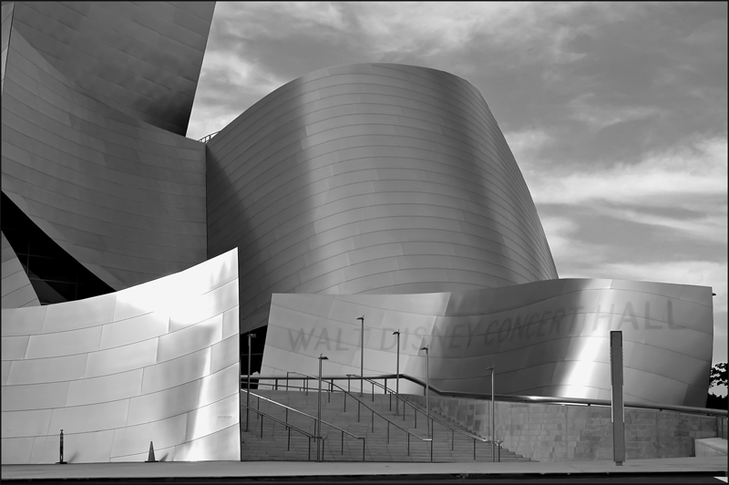 Walt Disney Concert Hall, is the new home of the Los Angeles Philharmonic, it is designed to be one of the most acoustically sophisticated concert halls in the world, providing both visual and aural intimacy for an unparalleled musical experience. From the stainless steel curves of its striking exterior to the state-of-the-art acoustics of the hardwood-paneled main auditorium, the 3.6-acre complex embodies the unique energy and creative spirit of the city of Los Angeles and its orchestra. it was designed by Frank Gehry, Architect.