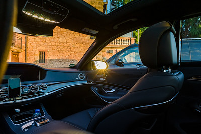 Luxury car interior with sunset lighting and reflections
